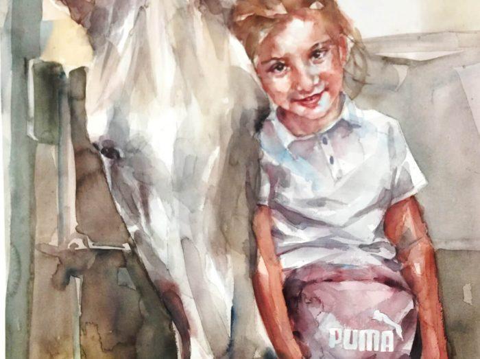 Niña con un caballo